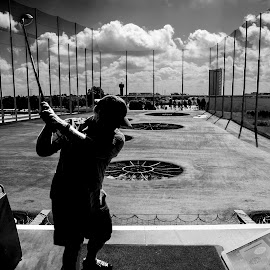 Driving into the sun by Kevin Dunn - Sports & Fitness Golf ( fore!, top golf, black and white, drive, silhouette, golf, driver, driving range )