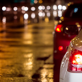"""Innocent droplets of rain"" by Paul Joseph - Transportation Automobiles ( dubai, cars, night, roads, rain, city at night, street at night, park at night, nightlife, night life, nighttime in the city )"