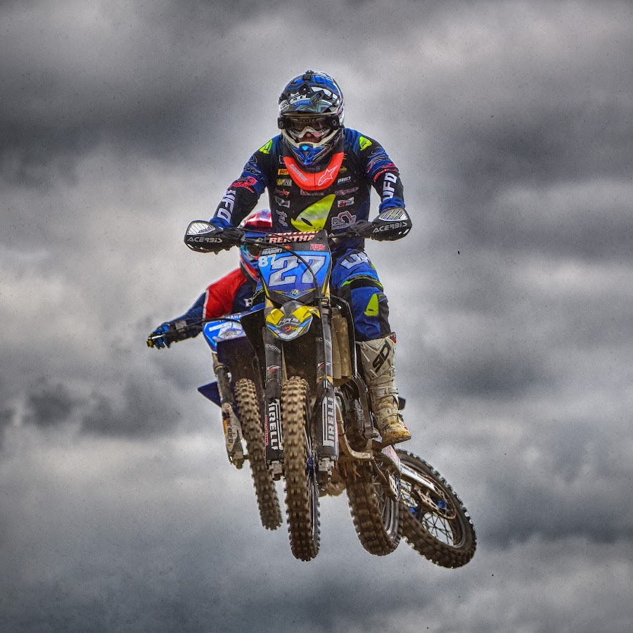 Hard Air Fight by Marco Bertamé - Sports & Fitness Motorsports ( clouds, speed, fight, number, 27, race, noise, jump, flying, red, motocross, blue, air, grey, high, duel )