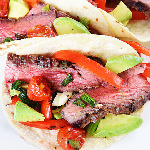 Pineapple-Marinated Flank Steak Tacos with Charred Tomato-Avocado Salsa