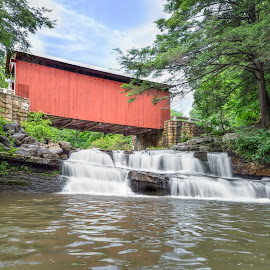 Packsaddle Covered Bridge and Waterfall by Kenneth Keifer - Buildings & Architecture Bridges & Suspended Structures ( countryside, crossing, old, stream, wood, splash, waterfall, stone, landscape, packsaddle, historic, national register of historic places, nature, packsaddle bridge, creek, somerset county, long exposure, covered, abutments, country roads, vintage, flowing, fairhope township, pennsylvania, scenic, rural, united states, kingpost truss, country, red, wooden, splashing, packsaddle covered bridge, covered bridge, cataract, brush creek, bridge, whitewater )