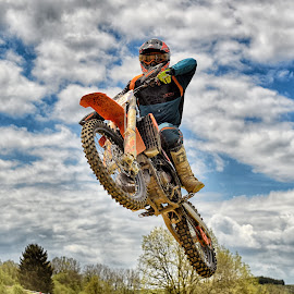 Crazy Jumper by Marco Bertamé - Sports & Fitness Motorsports ( clouds, speed, race, noise, jump, flying, red, motocross, blue, cloudy, grey, air, high )