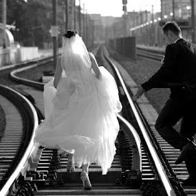 Crossing the line. by Aurel Virlan - Wedding Bride & Groom ( railway photo session, bride & groom, back and white )