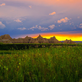 Badland's Sunset by Eugene Linzy - Landscapes Prairies, Meadows & Fields ( clouds, grasses, badland np, vacation, sunset, south dakota, prairie, spring )