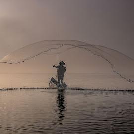 The Fisherman by Agus Sudharnoko - People Portraits of Men