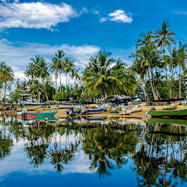 reflection of fisherman boat by Xicro Kuyon - Transportation Boats ( relax, travel, beach, asian, sky, tree, nature, village, working, journey, tourism, sunlight, palm, holiday, vacation, turquoise, outdoors, shore, reflection, coconut, tropical, ocean, coastline, landscape, exotic, coast, sun, island, tranquil, sri, transport, asia, water, clouds, sand, beautiful, tropic, sea, seascape, scenic, paradise, boat, morning, fishermen, wooden, blue, background, fishing, scenery, fisherman )