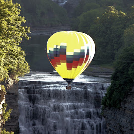 Over the Falls by Cal Brown - Transportation Other ( other, gorge, waterfall, canyon, transportation, new york, genesee, balloon, letchworth, flight, sunset, state park, evening, river )