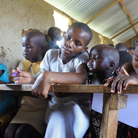 Studying  by Cyndi Rosenthal - Babies & Children Children Candids ( school, poverty, studying school children poverty africa, desk, africa )