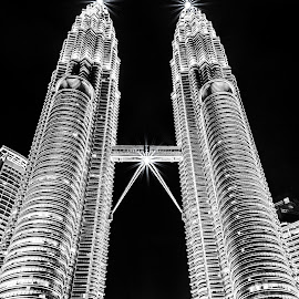 The Petronas Tower by Jan Murphy - Buildings & Architecture Architectural Detail ( detail, monochrome, black and white, silver, windows, malaysia, architecture, petronas towers, starlights, lights, details, towers, night, bridge, tall )