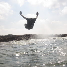 Jumping to the sea by Anees Al-Arafe - Sports & Fitness Swimming ( water, jumping, sports, talent, sea, jump )