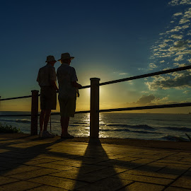 the couple  by Peter Schoeman - People Couples ( love, pathway, watching, sea, couple, beach, sunrise )