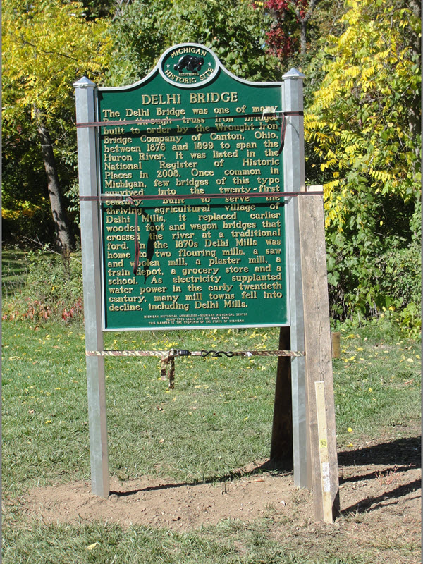 The Delhi Bridge was one of many Pratt through truss iron bridges built to order by the Wrought Iron Bridge Company of Canton, Ohio, between 1876 and 1899 to span the Huron River. It was listed in ...