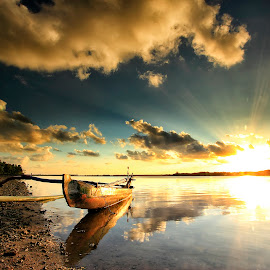 Golden Sunbeams by Bigg Shangkhala - Landscapes Sunsets & Sunrises ( reflection, sunset, cloud, rol, beach, boat, golden, rays )