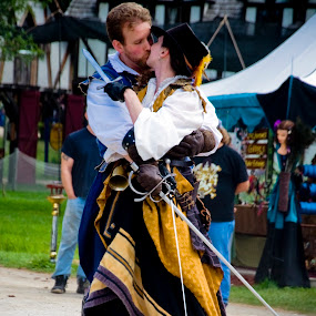 a stolen kiss by Brittany Humphrey - People Musicians & Entertainers ( renaissance, cast, actors, festival, fair, entertainment )