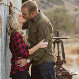 stolen moments by Kari McClure Webb - People Couples ( holiday, love, kiss, blonde, barn, plaid, outdoor, couple, marriage,  )