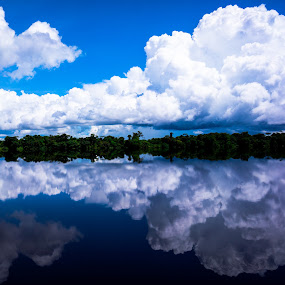 Cloudy and calm by Steve Outing - Landscapes Cloud Formations ( clouds, water, brazil, sky, tropical, rio negro, reflections, rain forest, amazonas, brasil, reflection, people, places, architecture, building,  )