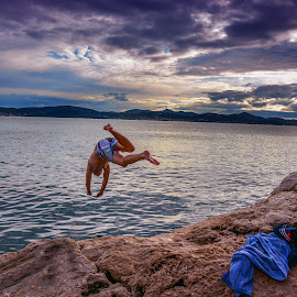 Into the Blue by Akshansh Garg - Landscapes Travel ( water, guy, cliff, clouds and sea, croatia, sea, cloudscape, ocean, travel, landscape, swimming, jump, sunset,  )