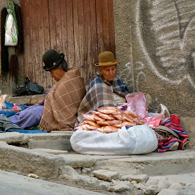 The Bread Seller by Leigh Thomson - People Street & Candids ( sellers, traditional, street scene, travel, people, women, city, hats, dress, bread, south america, costume, la paz, bolivia, vendors )
