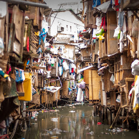Urban Decay by Joey Rico - City,  Street & Park  Street Scenes ( water, uban, clothers, slums, poor, house, decay )