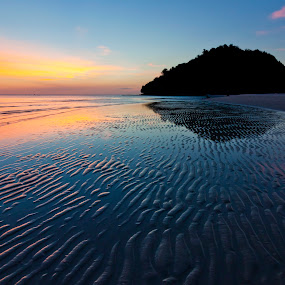 Sunset and wavy patterns on a beach. Borneo, Sabah, Malaysia by Macbrian Mun - Landscapes Sunsets & Sunrises ( curve, nobody, detail, surface, seasonal, relax, solitude, vibrant, travel, beach, borneo, sabah, sky, nature, weather, orange, lagoon, texture, twilight, malaysia, shape, holiday, vacation, textured, scene, ripple, islands, lines, tranquility, natural, golden, shore, reflection, colorful, tropical, line, ocean, beauty, sandy, seaside, coastline, landscape, exotic, coast, island, wavy, tranquil, asia, tide, shoreline, wet, evening, sunbeam, water, sand, peaceful, seashore, rippled, scenics, beautiful, backgrounds, romantic, sea, seascape, scenic, relaxation, pattern, blue, color, sunset, outdoor, background, cloud, scenery )