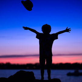 Hat Silhouette by Mike DeMicco - Babies & Children Child Portraits ( child, sweet, blue, sunset, happy, joy, silhouette, night, fun, boy, hat )