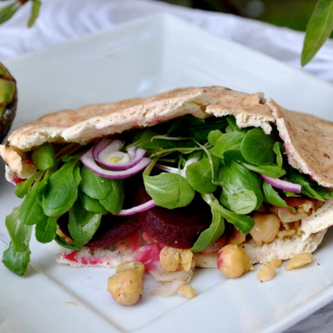 Chickpea Pita Stuffed with Hummus, Sliced Beets, Red Onions & Greens