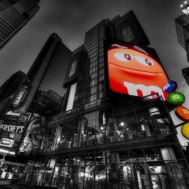 Mmm m&m by Graham Peel - City,  Street & Park  Markets & Shops ( spot color, sweets, confectionary, night, new york, manhttan )
