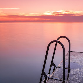 Ladder In Sunset by Sami Rahkonen - Landscapes Waterscapes ( ladder, water, smooth, colors, wallpaper, sea, ocean, landscape, baltic, sun, baltic sea, nature, color, sunset, summer, wet, bridge )