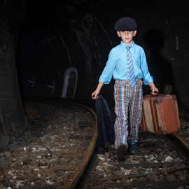 Child walking on railway road by Deyan Georgiev - Transportation Trains ( interior, walking, person, old, tube, railroad, line, way, travel, road, transportation, long, people, transit, entrance, child, subway, transport, woman, empty, path, dark, rail, train, light, end, vintage, speed, beautiful, track, journey, young, railway, female, outdoor, underground, boy, walk, tunnel )
