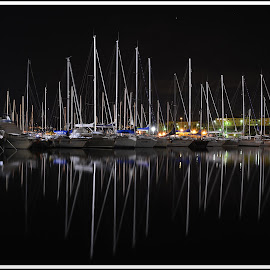 Rocking masts by Andrea Macherelli Bianchini - Transportation Boats ( reflection, europe, boats, sea, reflections, seascape, boat, sailboat, portovenere, nightscape, italia, bay, sailing, liguria, le grazie, nighttime, long exposure, sail, night, porto venere, italy )