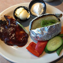Baby Ray's BBQ Chicken, Baked Potato and Sautéed Vegetables.