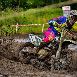 The Mud Race ! by Marco Bertamé - Sports & Fitness Motorsports ( mud, motocross, blue, speed, clumps, brown, pink, number, yellow, race, accelerating, 283 )