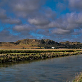McPheeter's Hill by Jeff Cottingham - Landscapes Mountains & Hills ( farmstead, hills, nebraska, canal, clouds )