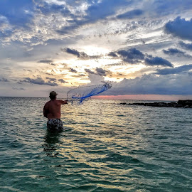 Sunset fisherman in the Gulf by Jeffrey Lee - People Street & Candids