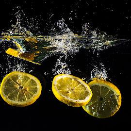Oranges by Dumitru Doru - Food & Drink Fruits & Vegetables ( water, orange, splash, food, fruits, vitamin, natural, light, black )