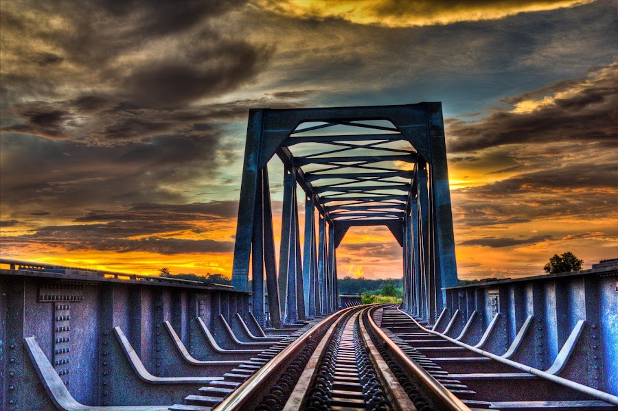 The Track by Ryan Dominguez - Backgrounds Holiday ( sunset bridge, train tracks, cloudy day, dark clouds, bridge,  )