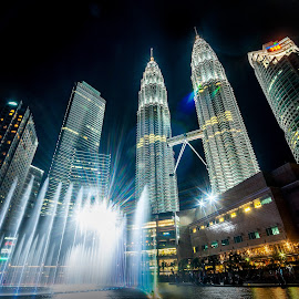 Twin Towers of Petronas by Joey Rico - Buildings & Architecture Statues & Monuments ( water, malaysia, architecture, kl, kuala lumpur, petrona, lights, towers, sunset, fountain, buildings, night, tover )
