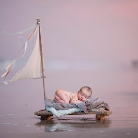 Beach Baby by Nicole Ferris - Babies & Children Babies ( water, sunset, sleeping, beach, baby, raft, boy, newborn,  )