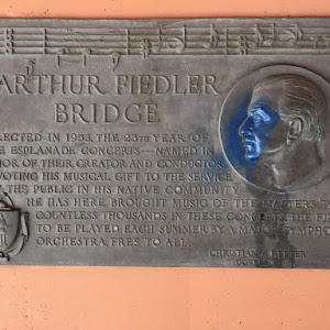 ARTHUR FIEDLER  BRIDGE  ERECTED IN 1953, THE 25TH YEAR OF  THE ESPLANADE CONCERTS ... NAMED IN  HONOR OF THEIR CREATOR AND CONDUCTOR.  DEVOTING HIS MUSICAL GIFT TO THE SERVICE  OF THE PUBLIC IN HIS ...