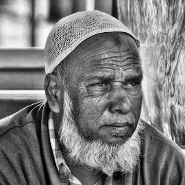 The Vendor by John Zyrlis - People Street & Candids ( faces, people, portrait, man, street photography,  )