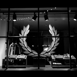 Fred Perry by DJ Cockburn - Black & White Objects & Still Life ( shop, monochrome, clothes, black and white, electric, christmas, sports shop, wreath, fred perry, commerce, grayscale, england, london, window, night, light, britain, shirt )