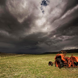 Stormy Clouds  by Þorsteinn H. Ingibergsson - Transportation Other ( clouds, iceland, sky, nature, structor, rusty, landscape, tractor, abandoned )
