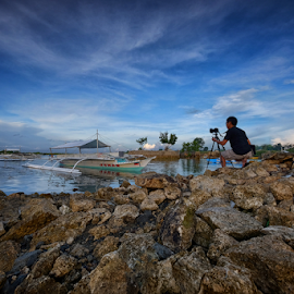 Dave the Photographer by Ferdinand Ludo - People Portraits of Men ( early dawn, rocky beach, photographer, dave, cordoba )