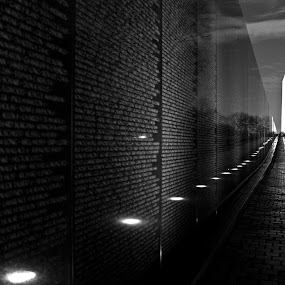 Vietnam Memorial by Bryan Rasmussen - Landscapes Travel ( lights, vietnam memorial, memorial, black and white, names, night, washington dc, war )