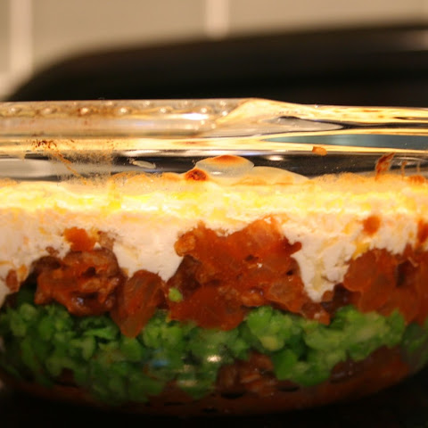 Lamb and Peas with Cheesy Topping
