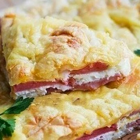 Cake Of Puff Pastry With Eggs And Ham