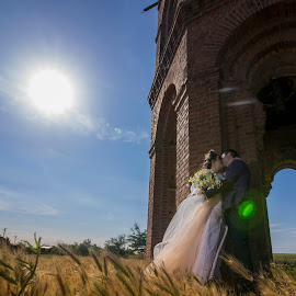 In the hit of the love! by Doru Iachim - Wedding Bride & Groom ( bride, love, groom, wedding, kiss, sun, tower )