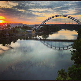 Nashville  by Mary Phelps - Buildings & Architecture Bridges & Suspended Structures ( sunrise, nashville, tennessee, reflection, cumberland river, bridge, river,  )