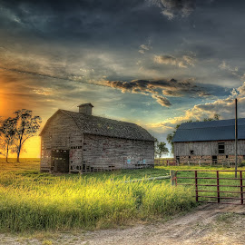Sunburnt by Chad Heggen - Buildings & Architecture Decaying & Abandoned ( clouds, iowa, fence, resting, old, red, grass, faded, sun )