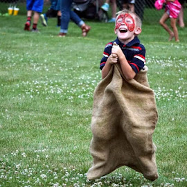 Sack race by Kim Price - People Street & Candids ( excitement, fourth of july, joy, fun, smiles )